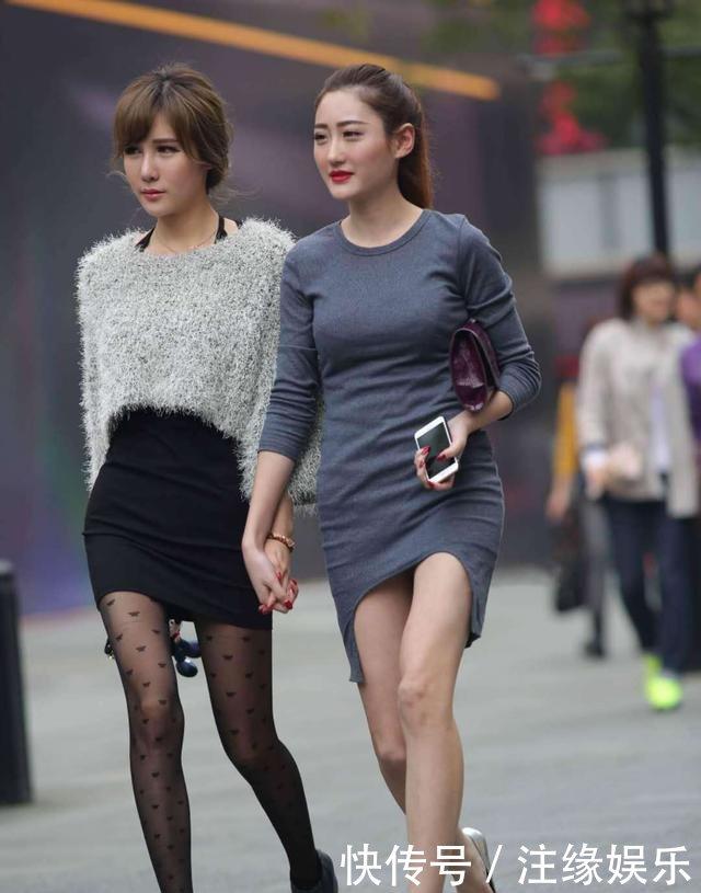 街拍街头面的性感,美女时尚,丝袜十足!性感女神放在把魅力外胸图片