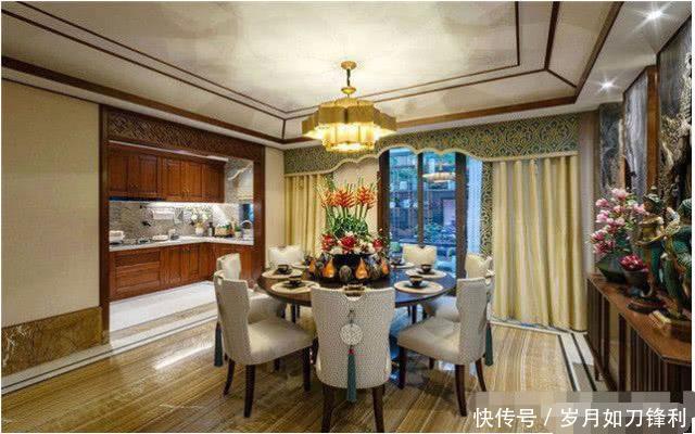 二层别墅装修效果图:餐厅 交流饭桌文化的餐厅,往往能够让人感受到家的温馨与氛围。在这张餐厅装修效果图中,餐厅沿用了客厅的装修风格,选用圆形的餐桌搭配实木布艺的餐椅,简约而又舒适;在餐桌的上方摆放一款极具东南亚风情的装饰物,个性十足;丰富的软装搭配、明亮的色彩呈现,让这个别墅餐厅变得极具风味。